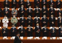 Delegates applaud as Chinese President Xi Jinping arrives for the opening session of China's National People's Congress (NPC) at the Great Hall of the People in Beijing, Friday, May 22, 2020. (AP Photo/Ng Han Guan, Pool)