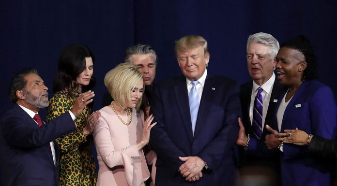 Faith leaders pray with President Donald Trump during a rally for evangelical supporters at the King Jesus International Ministry church on Jan. 3, 2020, in Miami. (AP Photo/Lynne Sladky)